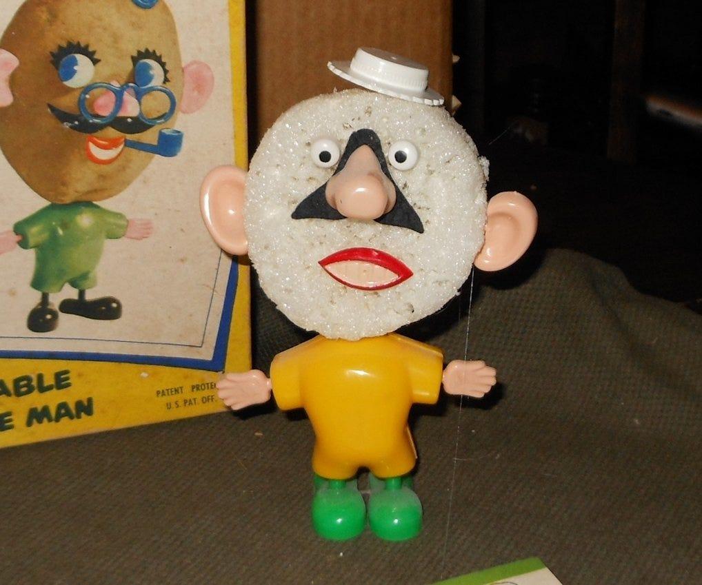 Old Mr. potato head parts on some kind of styrofoam ball.