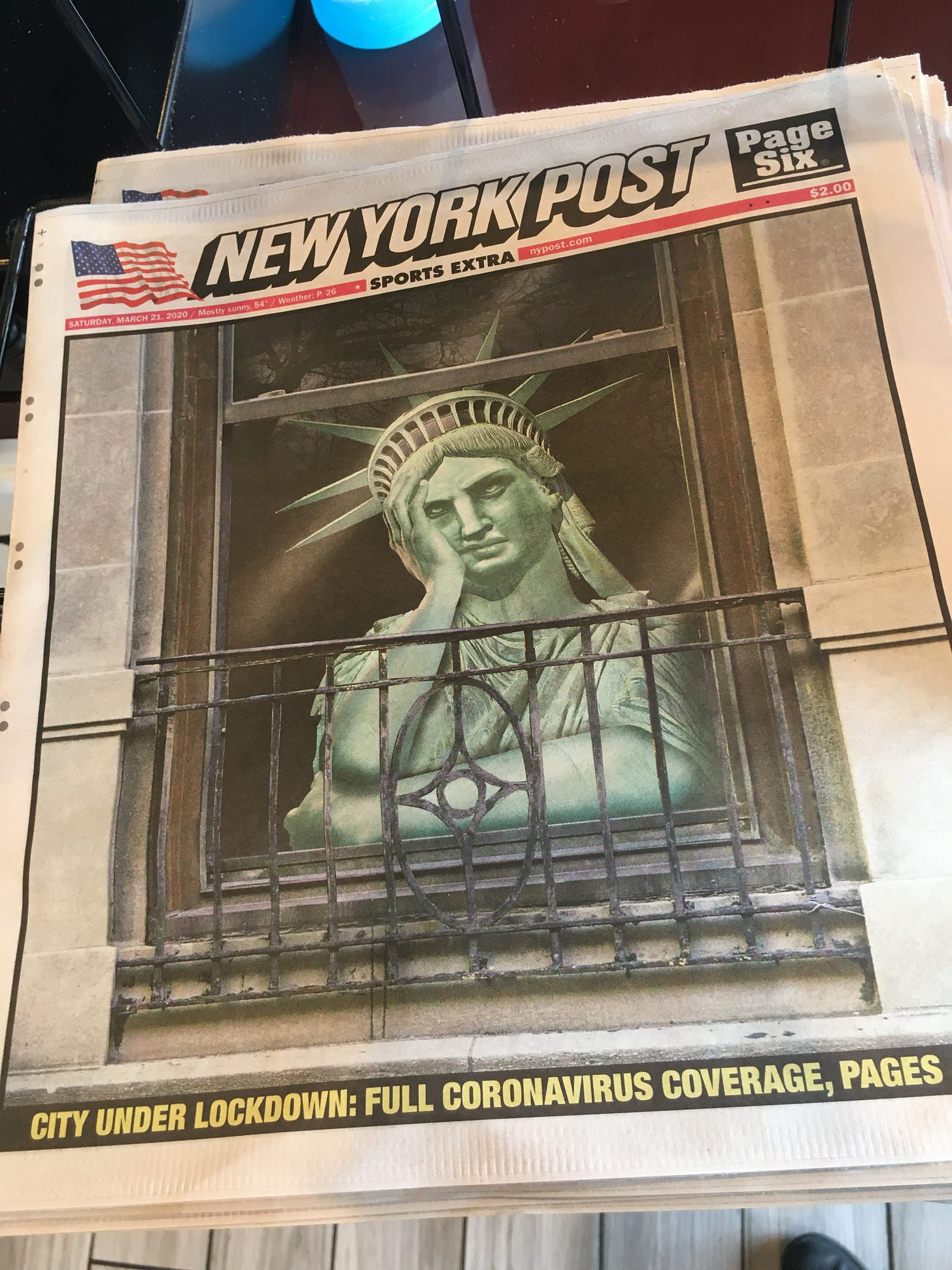 new york post showing the statue of liberty locked in their apartment looking out the window