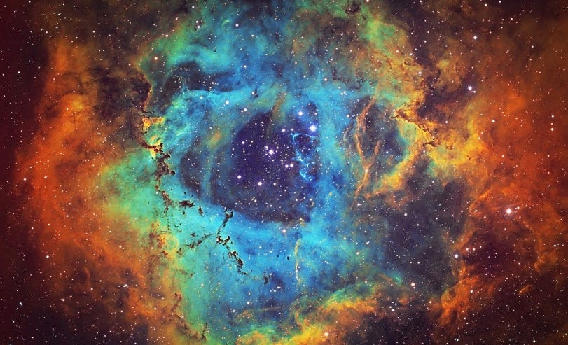 The Rosette Nebula 5,200 light years away (Source).