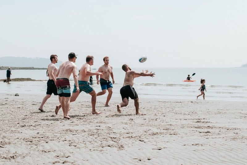 Men playing on the beach