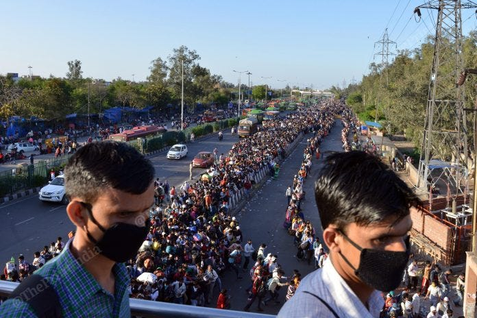 The migrants queueing up to board buses organised by the Delhi government at the Anand Vihar Bus Terminal, New Delhi. Photo: Suraj Singh Bisht | ThePrint