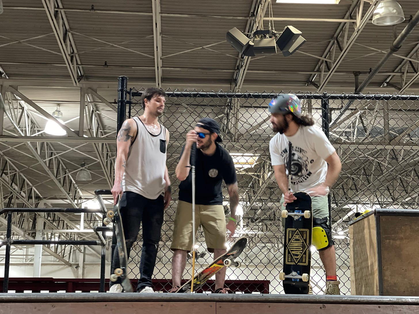 Blind Skaters, Nick Mullins (left), Justin Bishop (middle) and Anthony Ferraro talk at the top of a mini pipe
