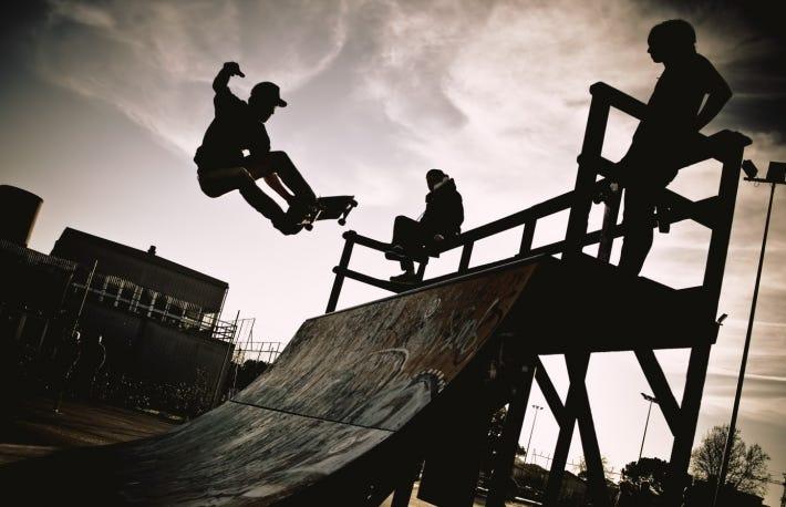 https://www.shutterstock.com/image-photo/skateboarder-jumping-on-ramp-backlight-makes-376965646