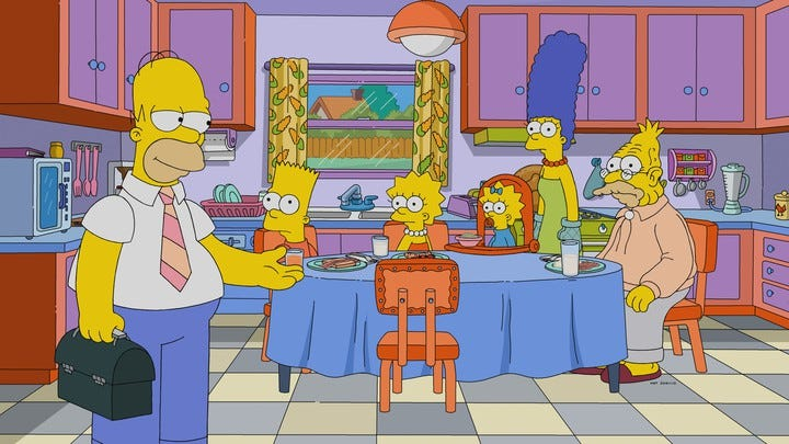The Simpsons family sits around the breakfast table