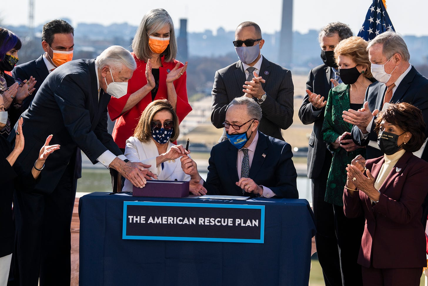 From left, House Majority Leader Steny Hoyer, D-Md., Speaker of the House Nancy Pelosi, D-Calif., and Senate Majority Leader Chuck Schumer, D-N.Y., sign the American Rescue Plan Act at a bill enrollment ceremony on the West Front of the Capitol after the House passed the $1.9 trillion covid-19 relief package, on Wednesday, March 10, 2021. (Photo By Tom Williams/CQ-Roll Call, Inc via Getty Images)