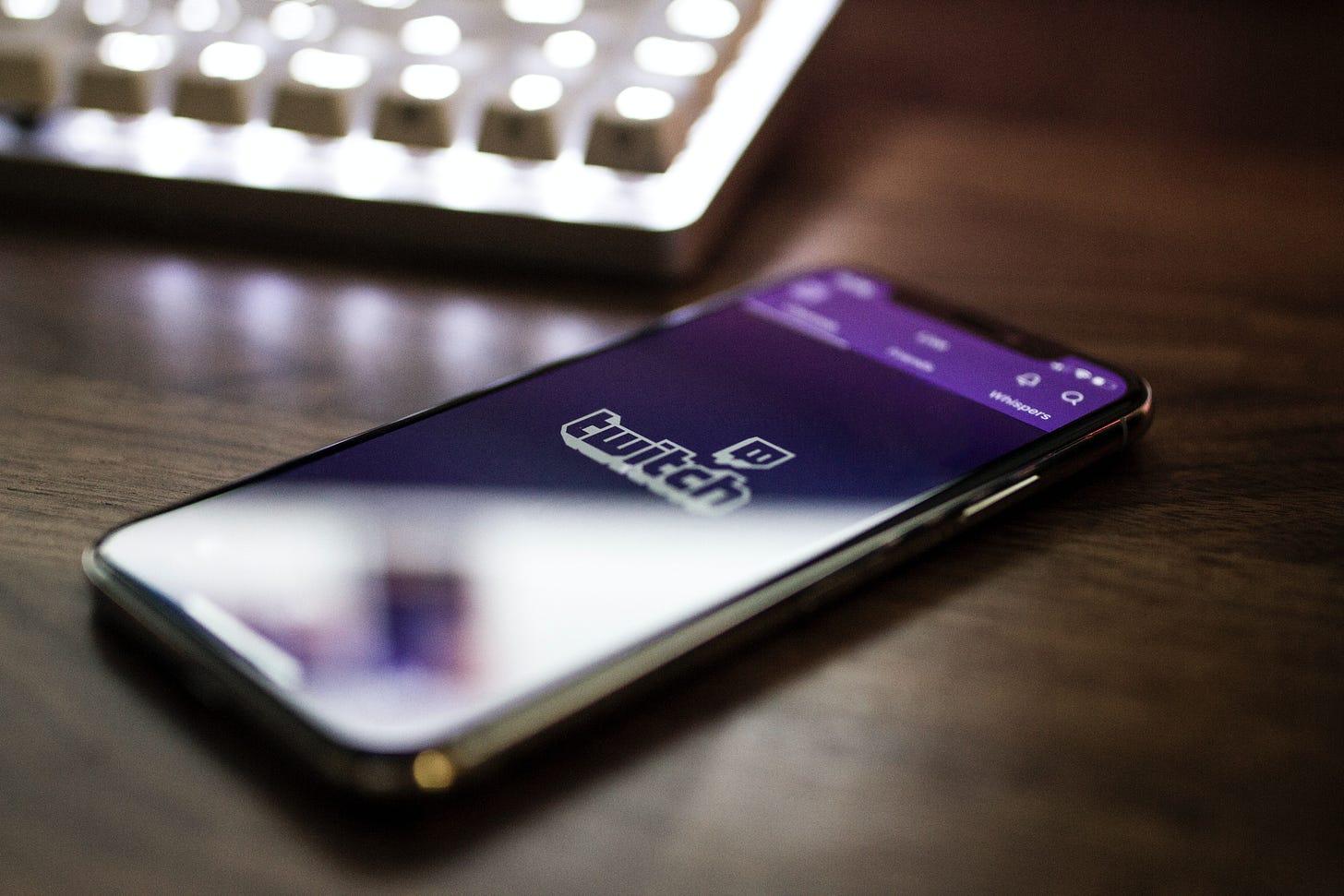 Twitch open on a smartphone. (Caspar Camille Rubin / Unsplash)