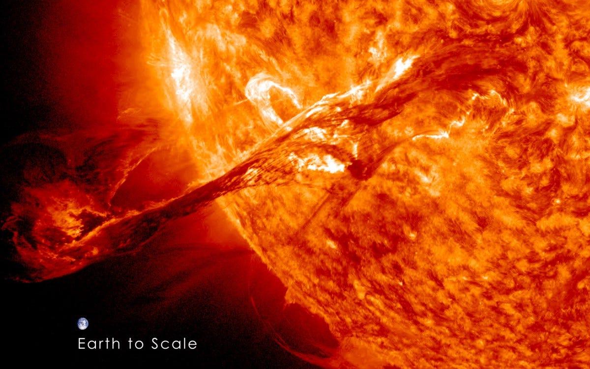 A solar filament compared to the Earth.