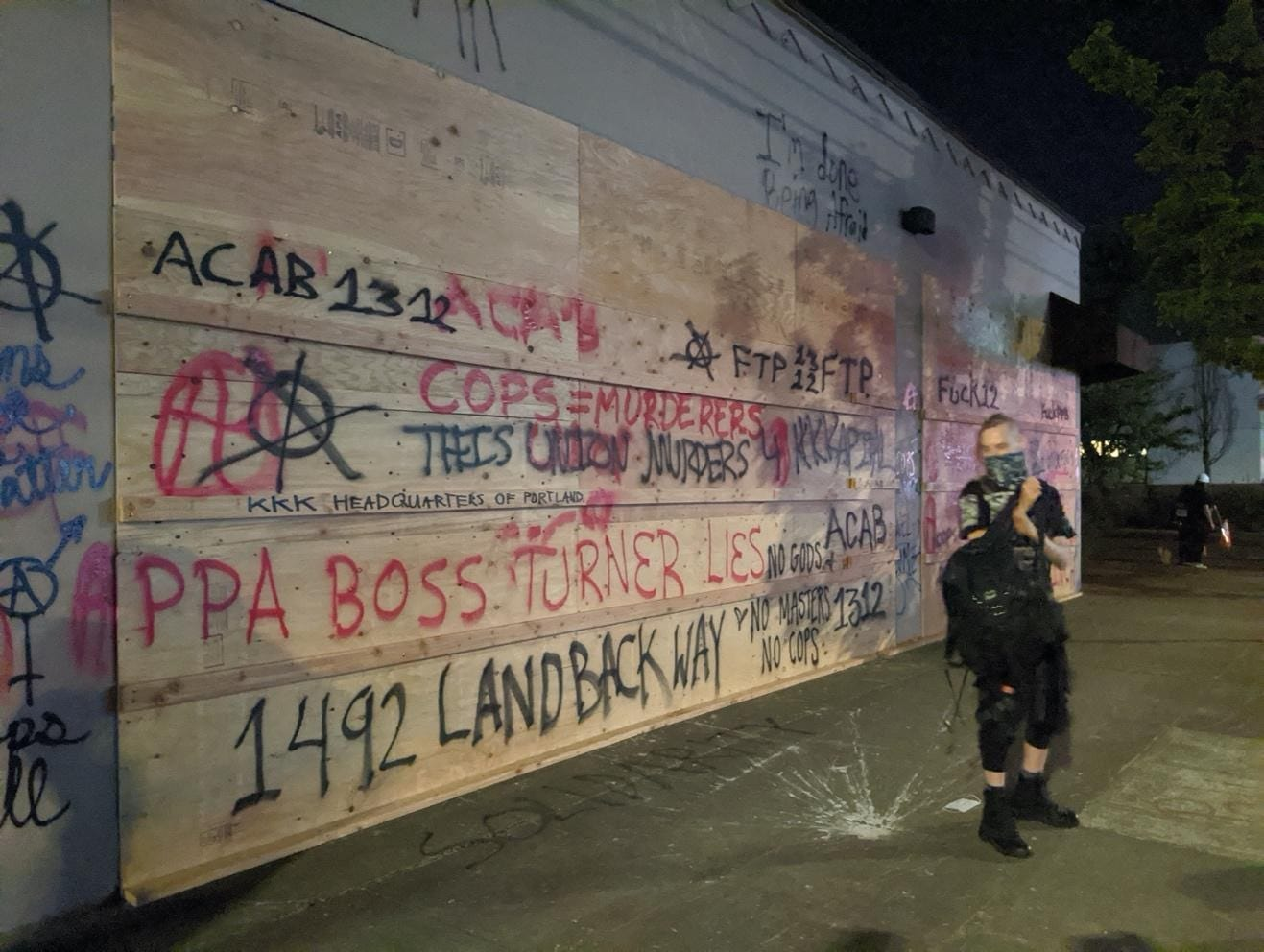 A picture containing text, outdoor, graffiti  Description automatically generated