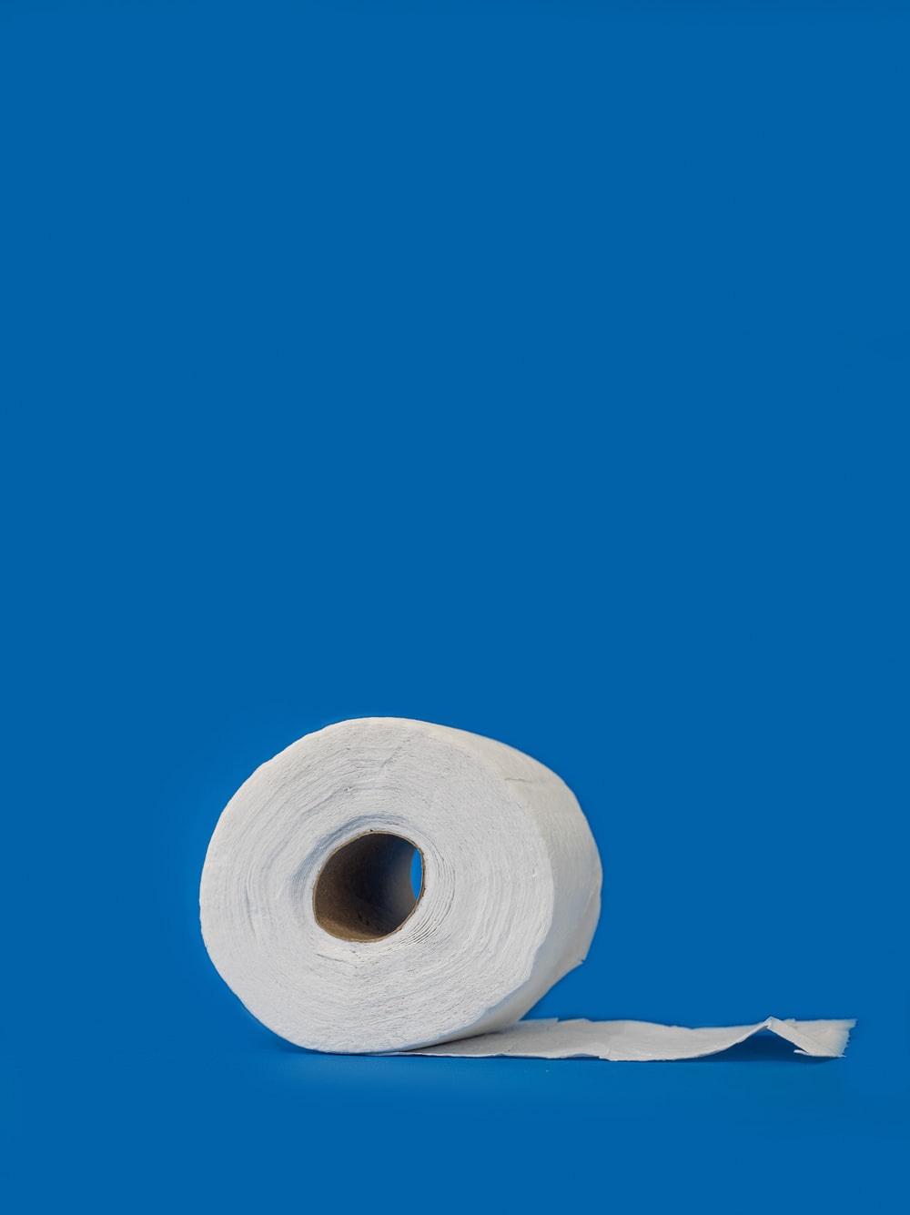 white tissue roll on white textile