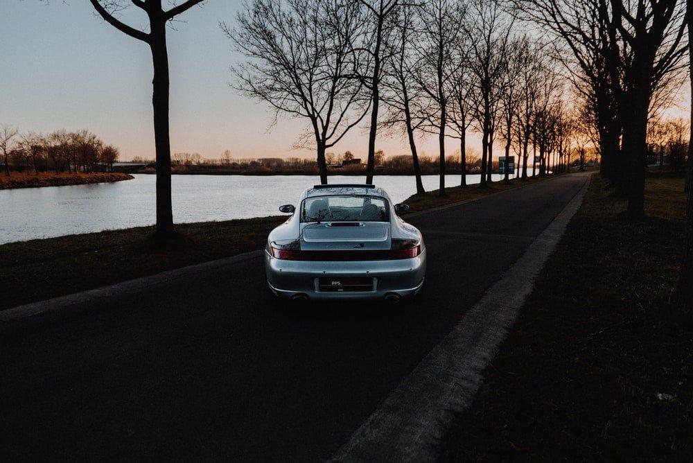 white car parked on sidewalk during sunset