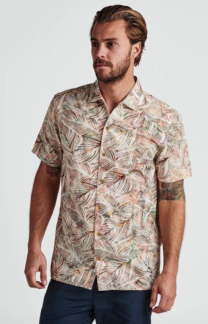 a man wears the roark revival java leaf shirt. it looks good