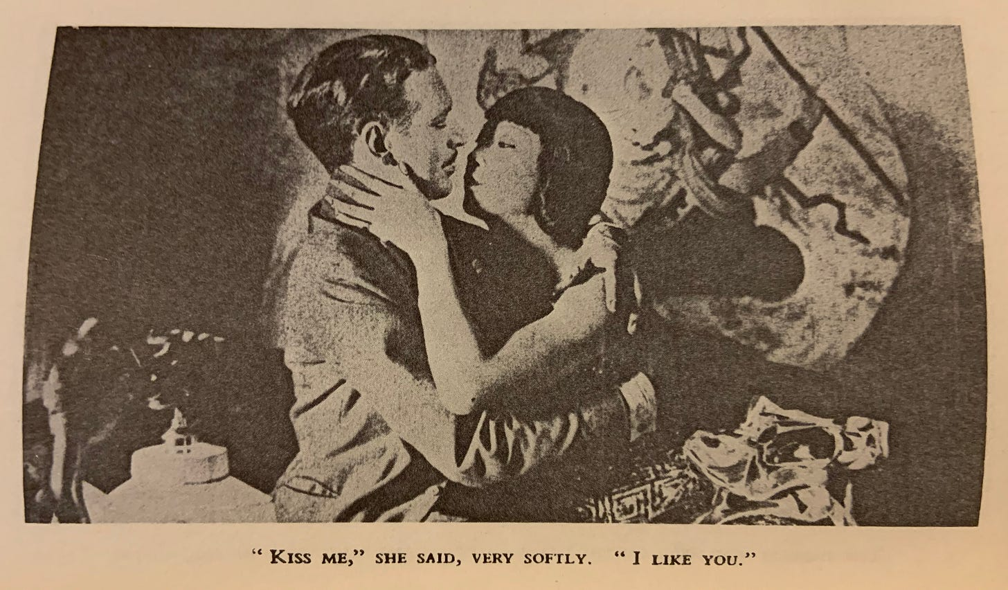 Anna May Wong embraces her co-star, Jameson Thomas, in Piccadilly, circa 1929. Their kiss was filmed but later cut from the final reel.