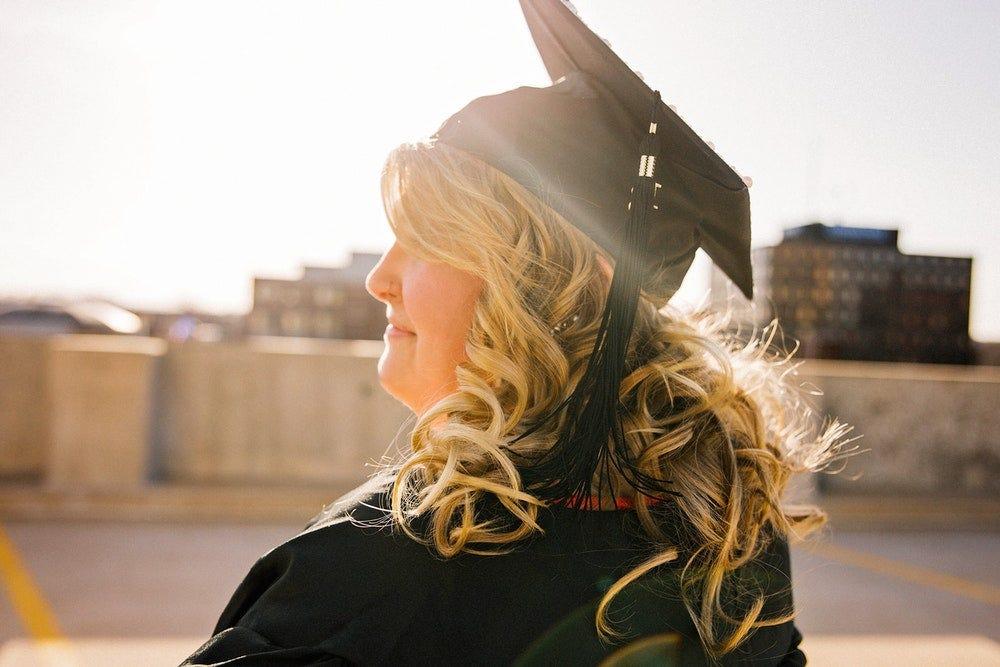 woman wearing academic regalia during daytime