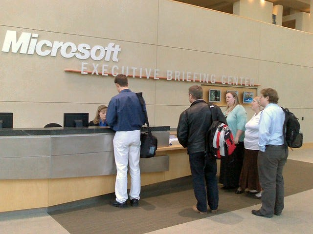 Photo of people being welcomed at the Microsoft Executive Briefing center