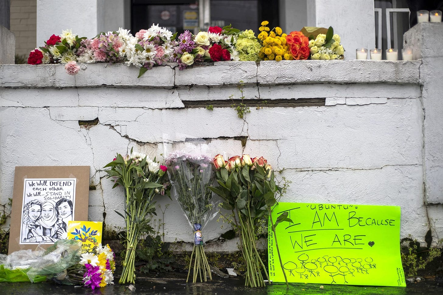 Flowers and signs at a makeshift memorial outside the Gold Spa in Atlanta on Wednesday.