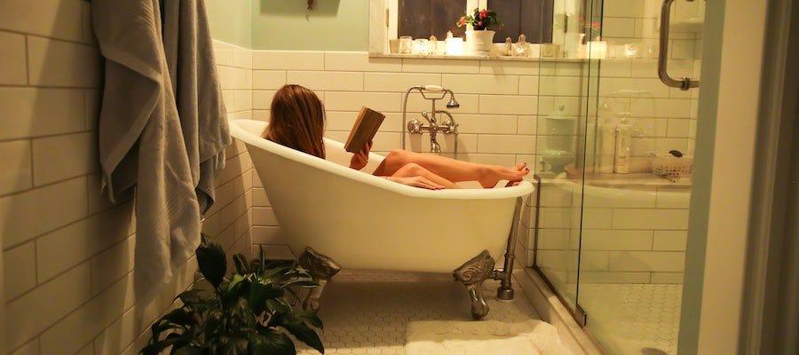 Lady reading in bathtub