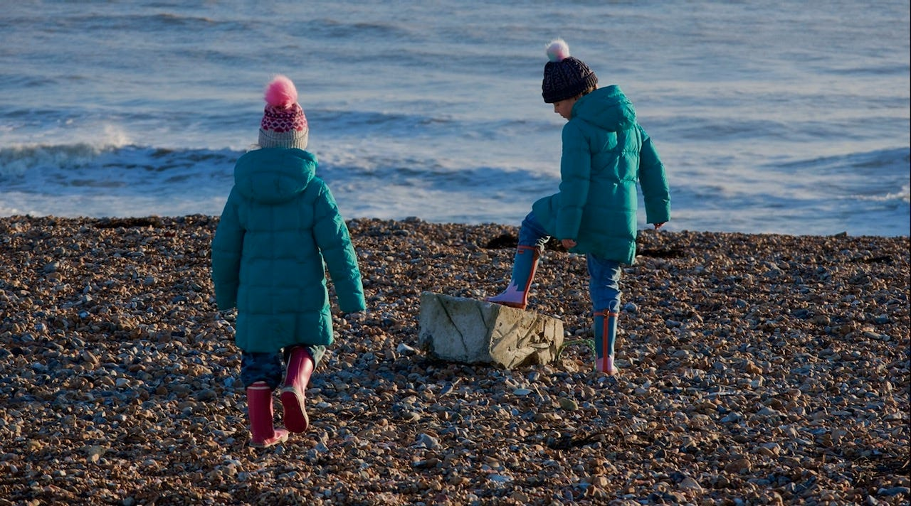 Two girls playing on Shoreham Beach