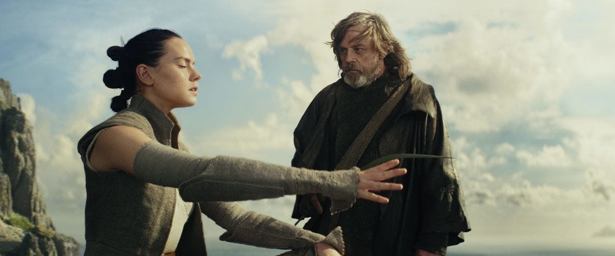 Luke teaches Rey the ways of the Force.