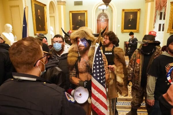 Trump supporters inside the Capitol after they stormed barricades and entered the building.