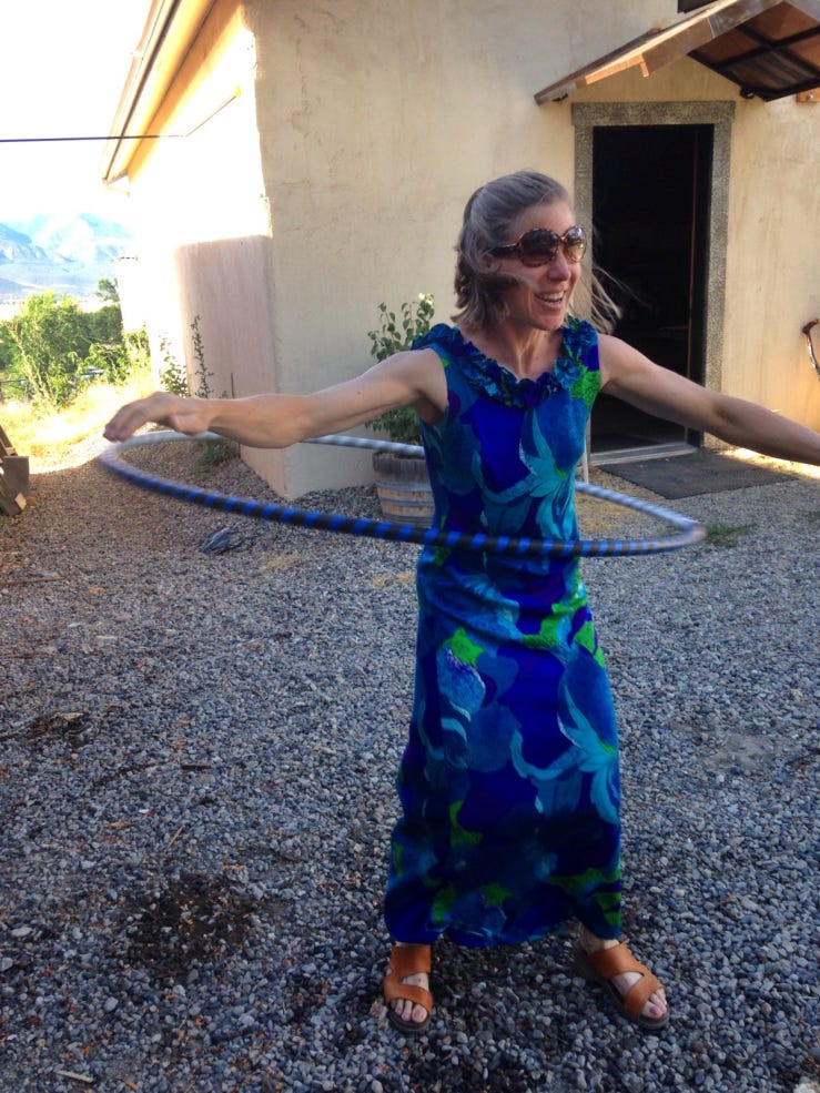 This image has an empty alt attribute; its file name is hawaiidresshulahoop.jpg