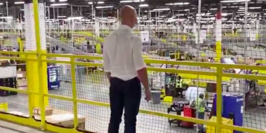 Amazon CEO Jeff Bezos looks on during a surprise to a Dallas warehouse in April 2020. Photo courtesy of Amazon