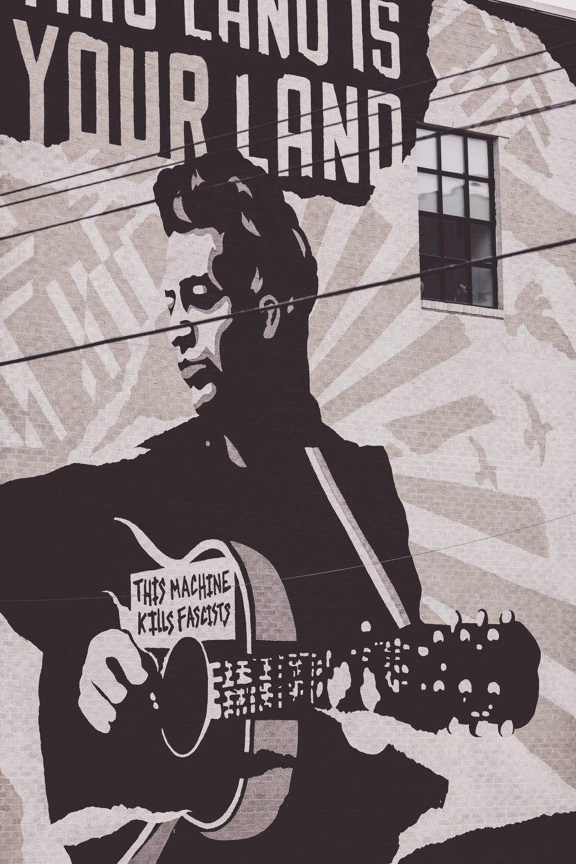 man playing guitar poster