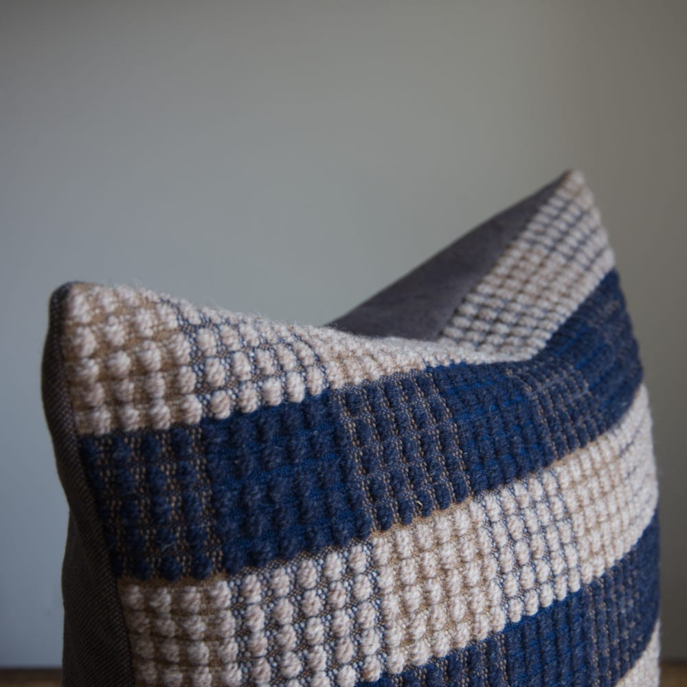 Closeup of the top half of a textured cushion