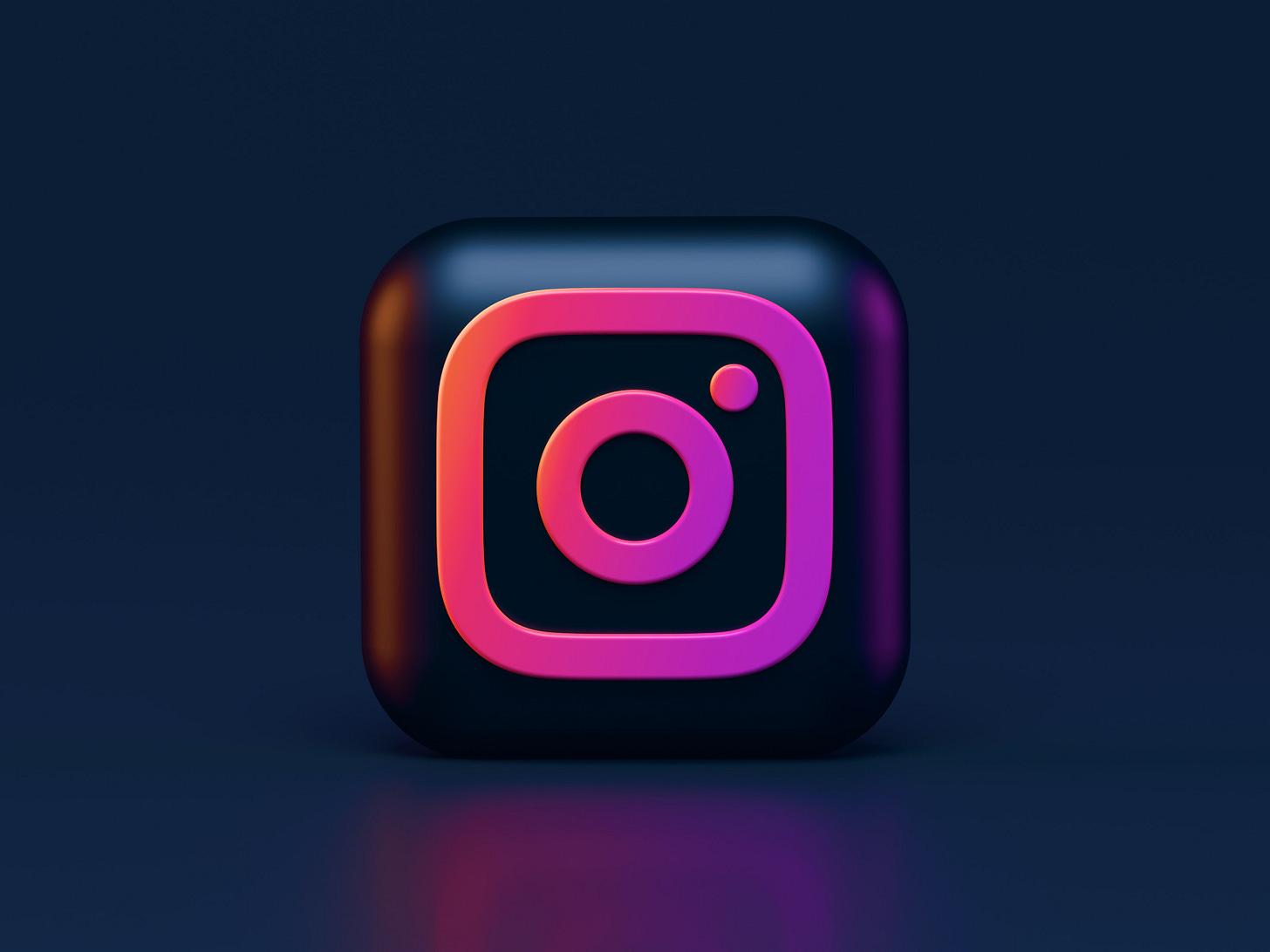 Illustration of Instagram's logo in black and pink. (Alexander Shatov / Unsplash)