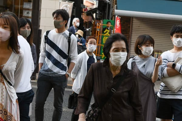 Shoppers in Tokyo last month. Face masks were a common sight in the city long before the coronavirus arrived.