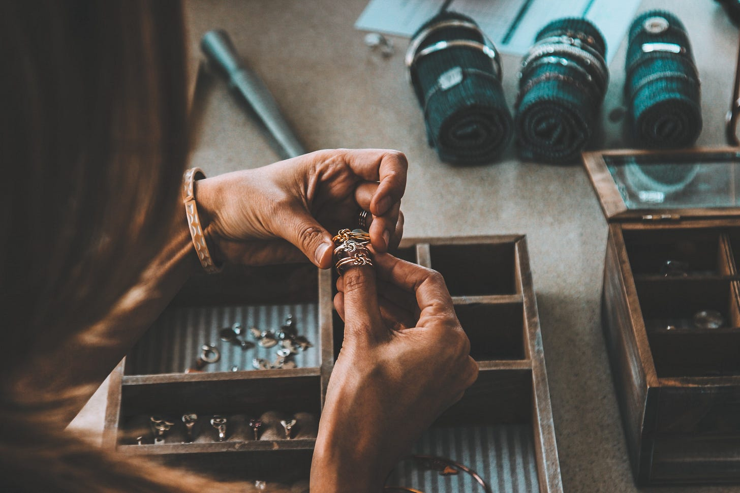 black woman's hands making jewellery for article by Larry G. Maguire