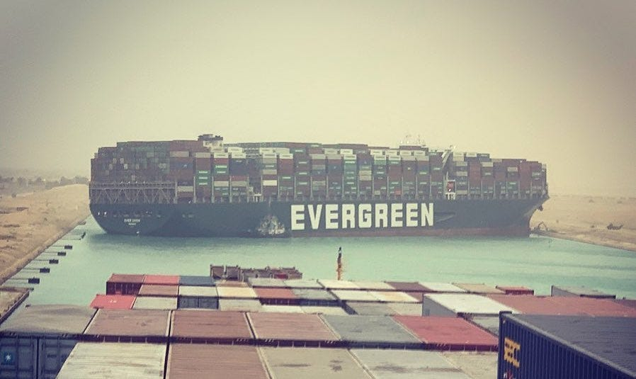 "Picture of container ship with the owner's name ""EVERGREEN"" prominently visible"