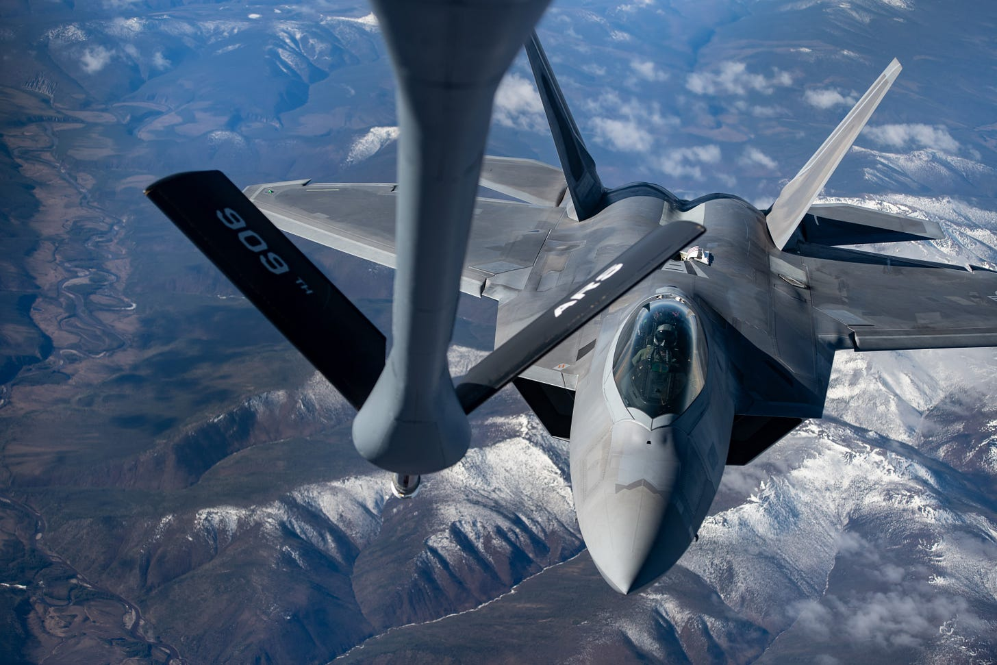 An F-22 is refueled mid-air