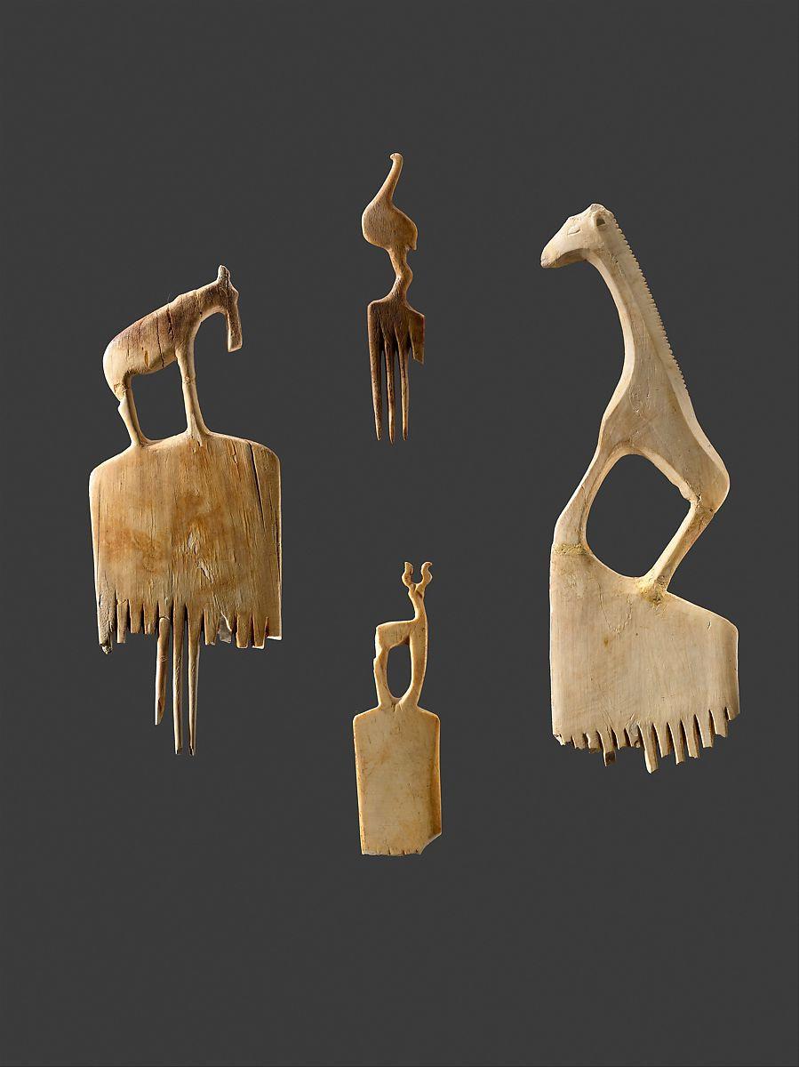 Comb with a giraffe, Ivory (elephant)