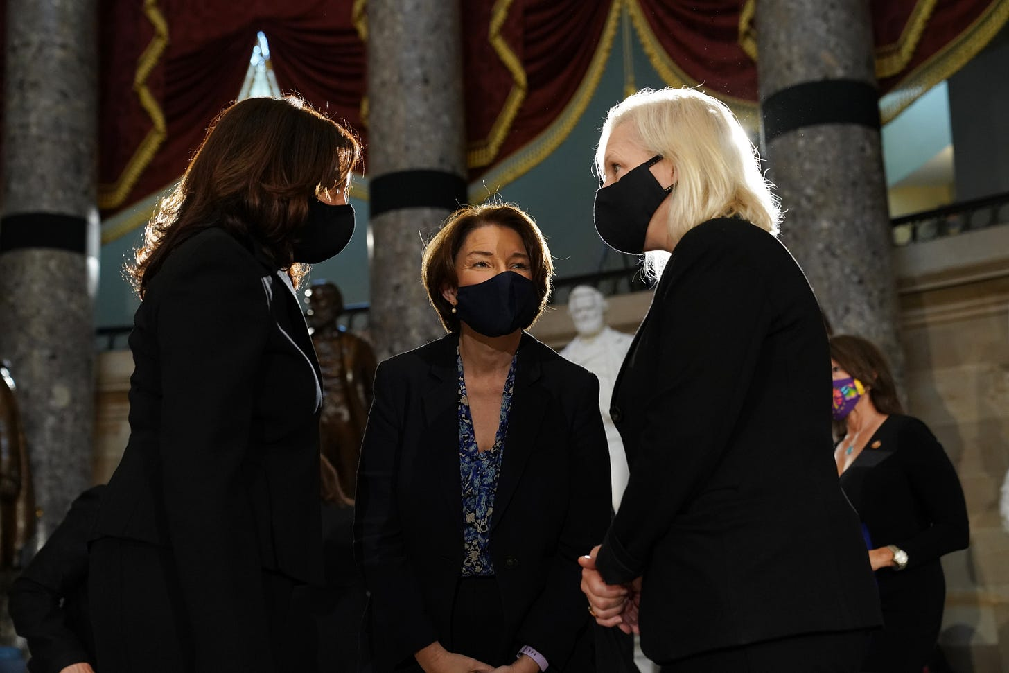 Democratic U.S. Vice Presidential nominee Sen. Kamala Harris (D-CA), Sen. Amy Klobuchar (D-MN) and Sen. Kirsten Gillibrand (D-NY) speak prior to a memorial service in honor of the late Associate Justice Ruth Bader Ginsburg in the Statuary Hall of the US Capitol, on September 25, 2020 in Washington, DC.