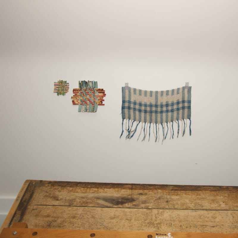 one textile and two paper weavings on the wall