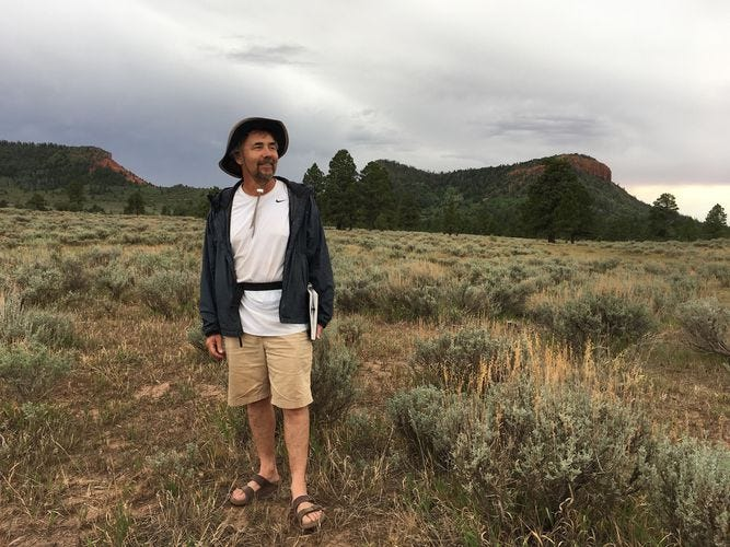 """(Courtesy of David Gessner) Author David Gessner stands before the Bears Ears Buttes in 2019 while researching his book """"Leave It As It Is: A Journey Through Theodore Roosevelt's American Wilderness,"""" which was published by Simon & Schuster in August."""