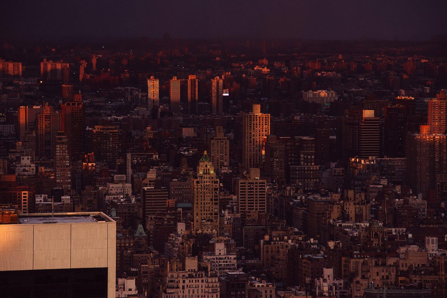 A view up Manhattan of apartment blocks at sunset.