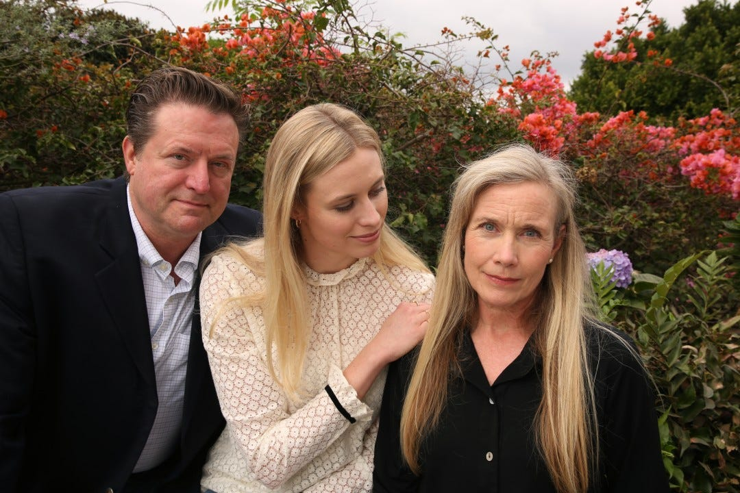 Hayley Hodson, center with her parents, Jimmy, and Sonya.
