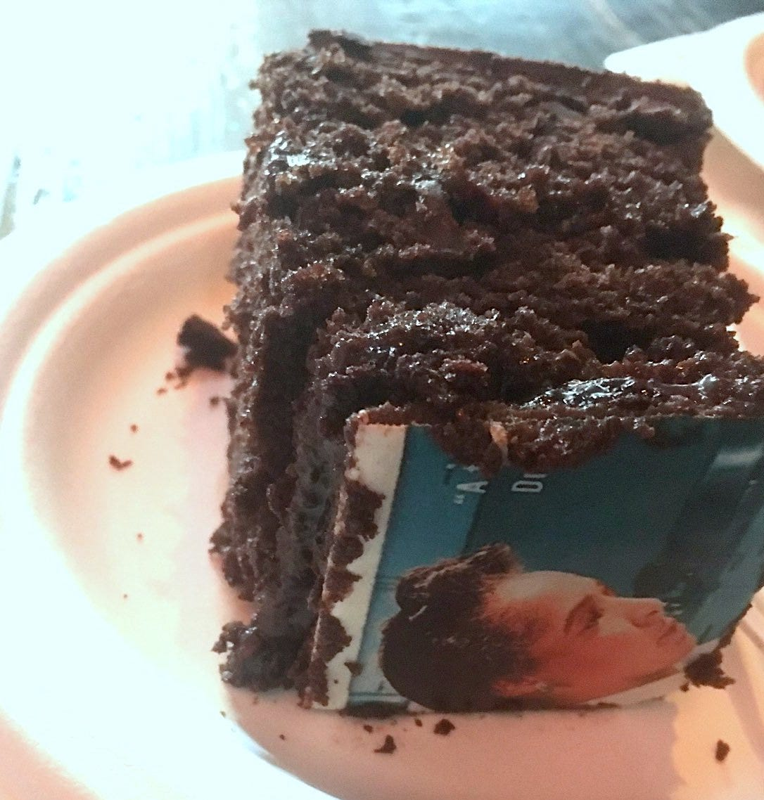 chocolate layer cake square with book cover image of Flemmie Kittrell on top