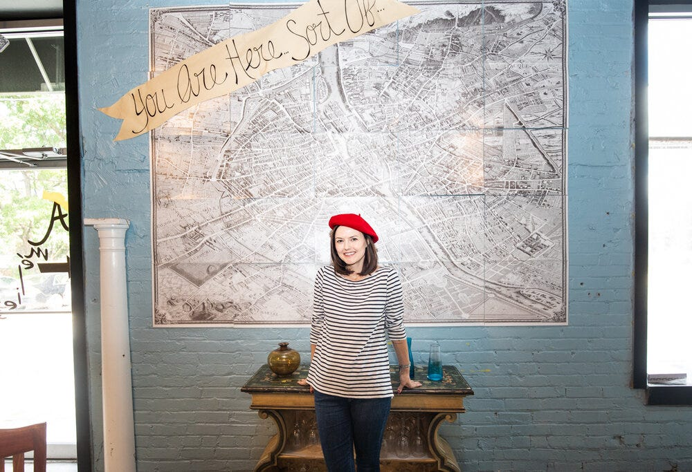 """""""You Are Here, Sort Of"""" at Amélie's Bakery in Atlanta."""