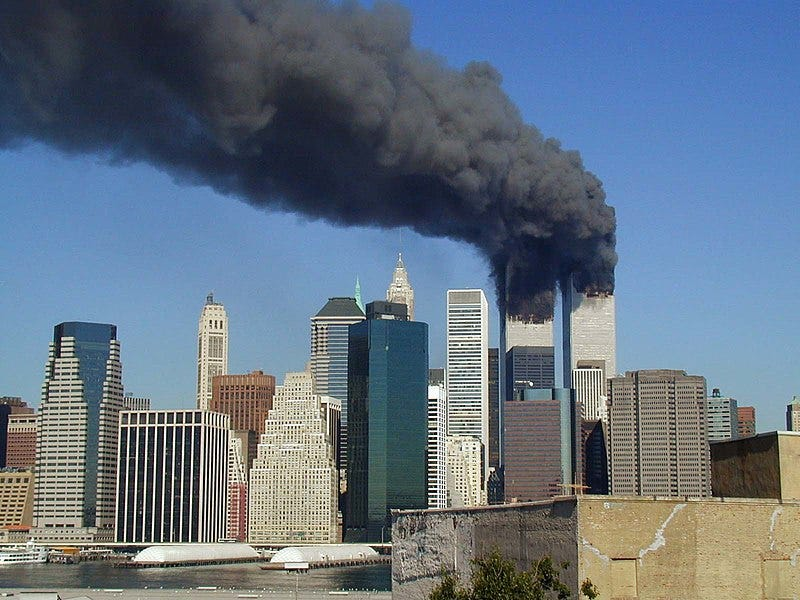 Black smoke billowing over Manhattan from the Twin Towers