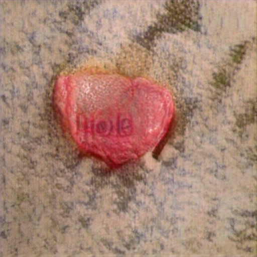 """It's heartshaped in the sense that it has a butt-like cleft on top. A weird yellow stain exudes from the candy. It says """"Hole"""" or maybe """"Mole"""""""