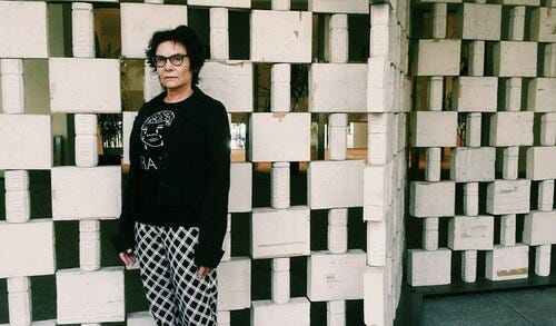 An image of director Salome Chasnoff, standing in front of a wall.