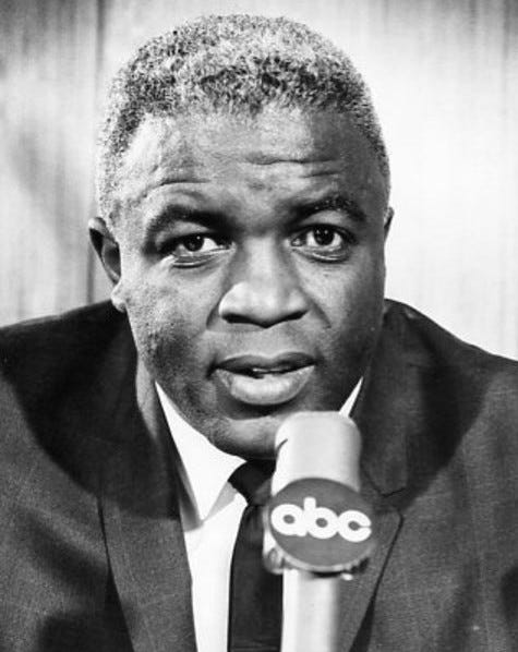 An aging black man in front of a microphone