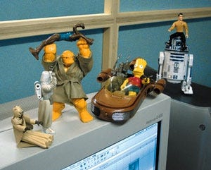 Just a few of the action figures that make Ron Pelinka's workspace distinctive.