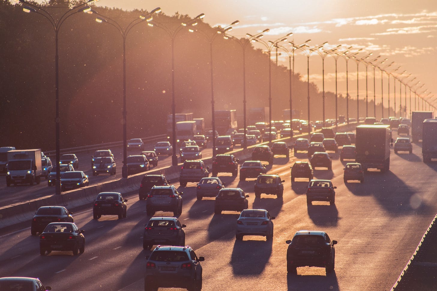 image of cars on a freeway making their way to work on a sunny morning
