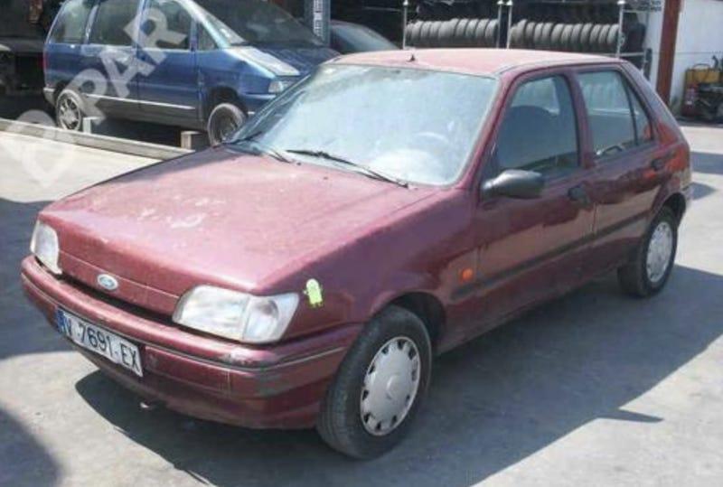 Maroon Ford Fiesta 1995 was my first work vehicle
