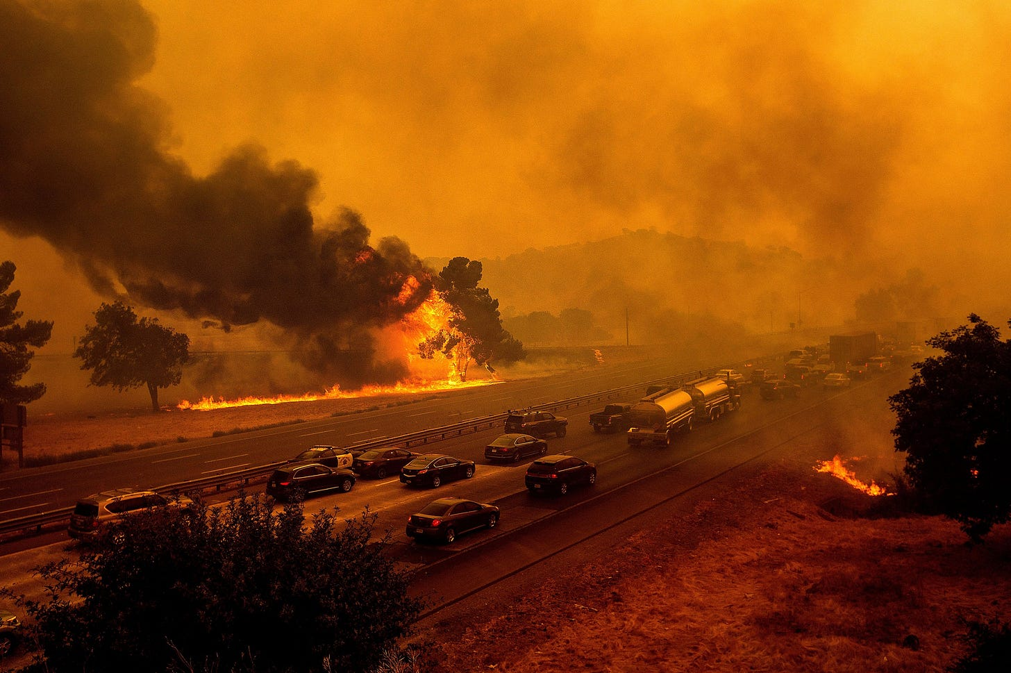 Fires on both sides of a busy highway.