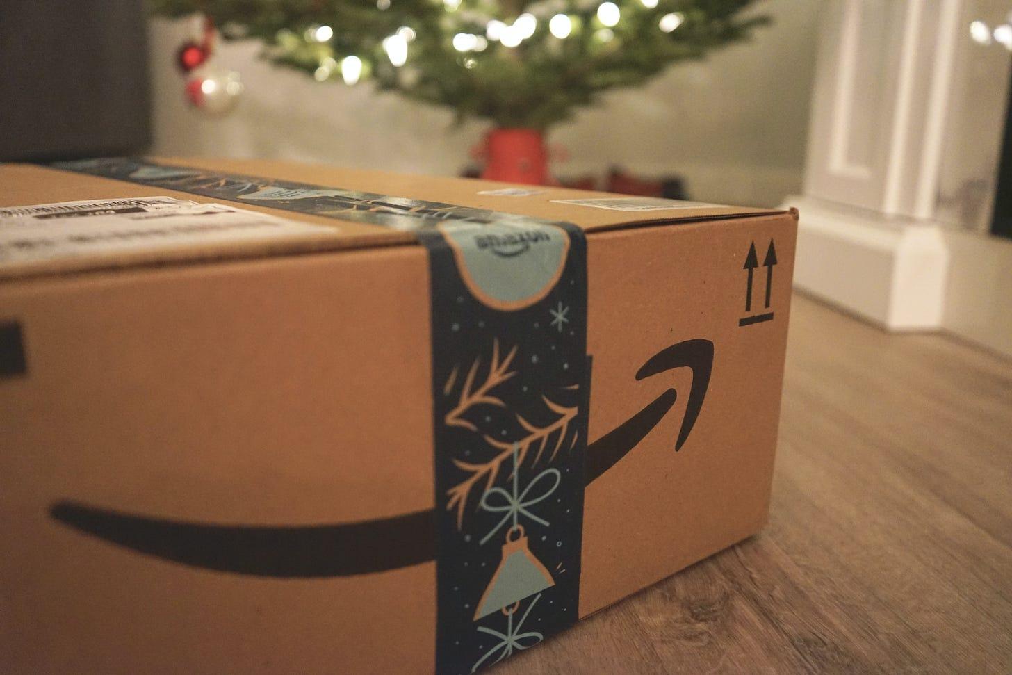 Photo of an Amazon box under a Christmas tree. Wicked Monday / Unsplash
