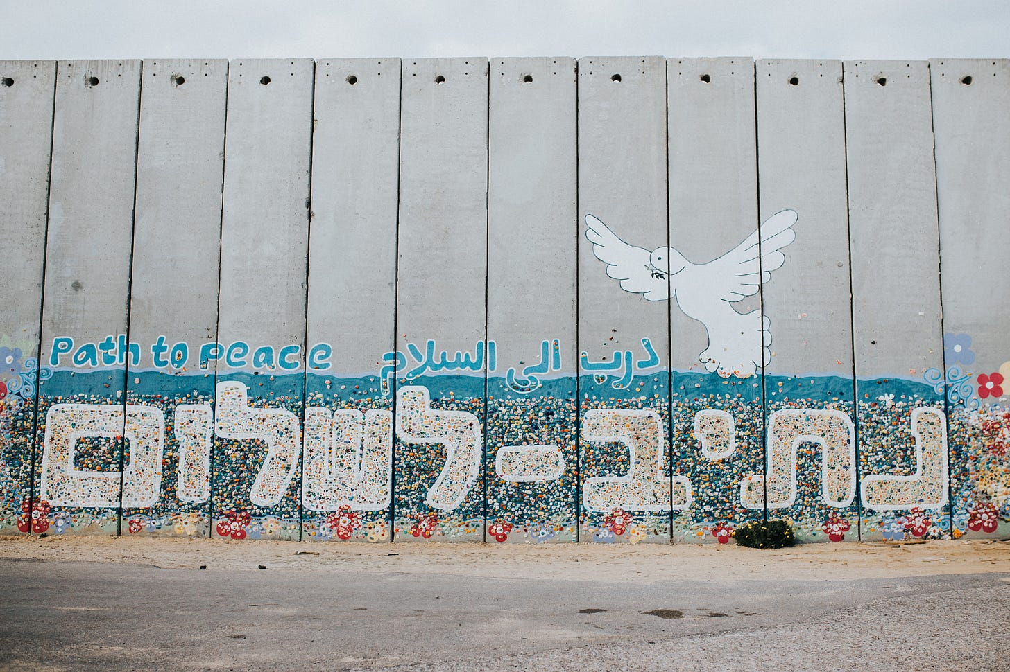 """""""Path to Peace"""" wall art painting in English, Arabic, and Hebrew with a dove—in Netiv HaAsara facing the Gaza border"""